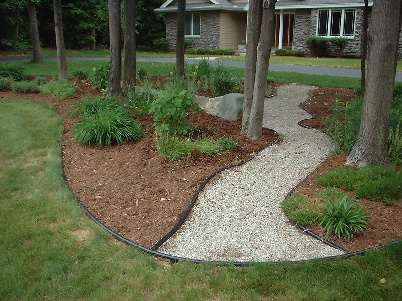 walkways and pathways of pea stone pebbles crushed gravel and